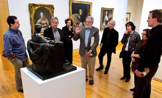 Professor Jerome Murphy, center, describing his contemplative engagement with a statue of Abraham Lincoln.